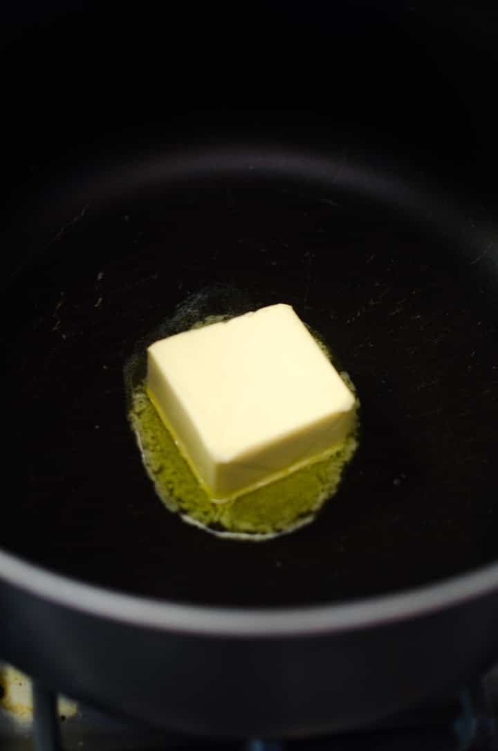 Melt butter in a very large soup pot over medium heat.