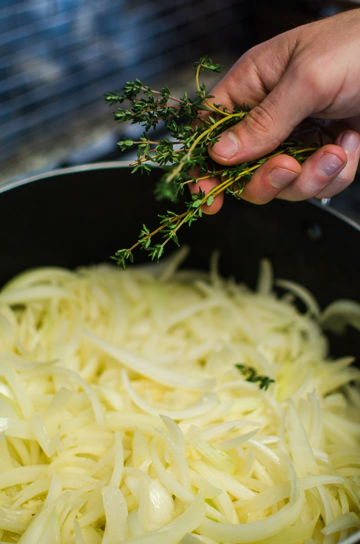 Add the fresh thyme and bay leaves to the soup pot.