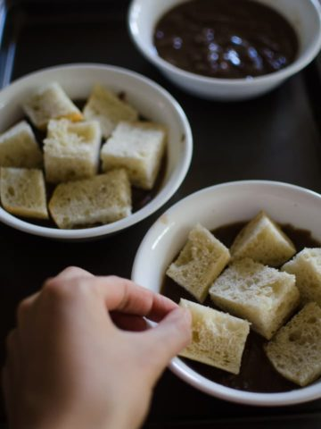 Top each bowl with the bread cubes