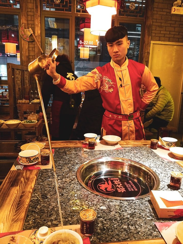 Sichuan restaurant with a special tea pourer using a tea pot with an extra long spout
