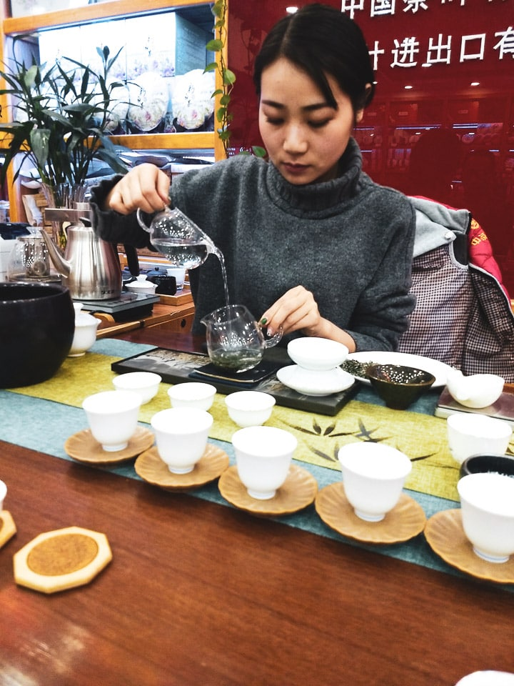 Xi'an tea shop with sales person pouring tea in a tea tasting