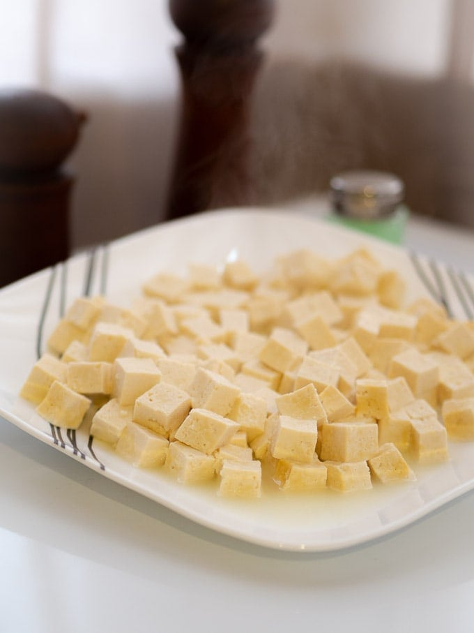 A plate of cubed tofu heated in the microwave
