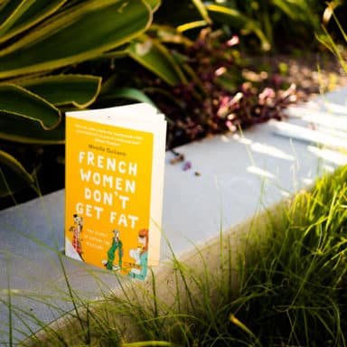 French Women Don't Get Fat book sitting in the garden