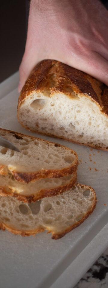Alex slicing bread for 5-minute garlic bread recipe