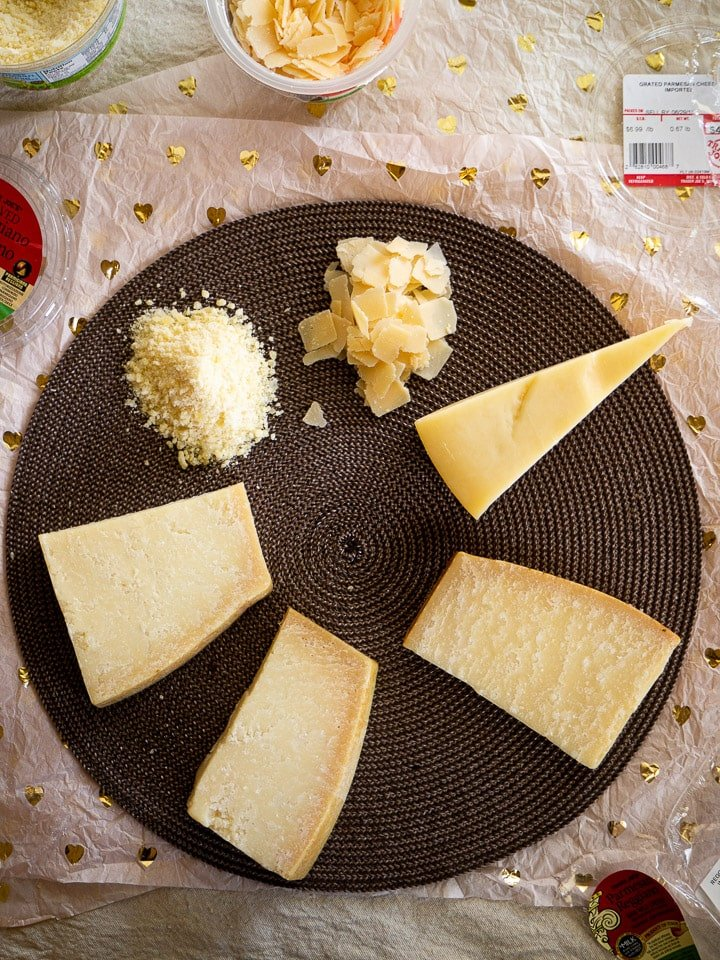 Overhead view of all 5 samples of Parmesan, Parmigiano-Reggiano, and Grana Padano in a circle