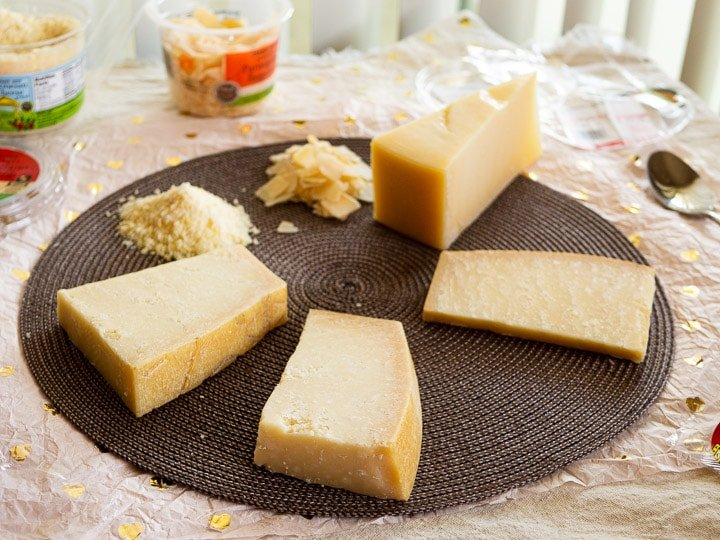 Side view of all 5 samples of Parmesan, Parmigiano-Reggiano, and Grana Padano in a circle
