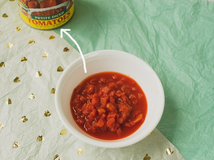 Close up look of petite diced canned tomatoes for ratatouille recipe