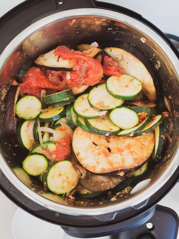 Instant Pot on sauté mode with all ingredients for ratatouille recipe