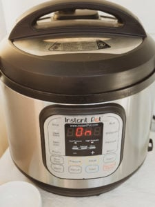 Front view of instant pot duo 6-quart version 2 showing ON on display panel