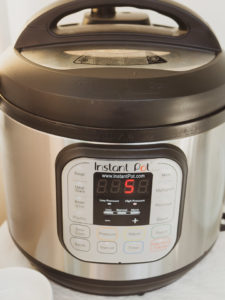 Front view of instant pot duo 6-quart version 2 showing 5 on display panel