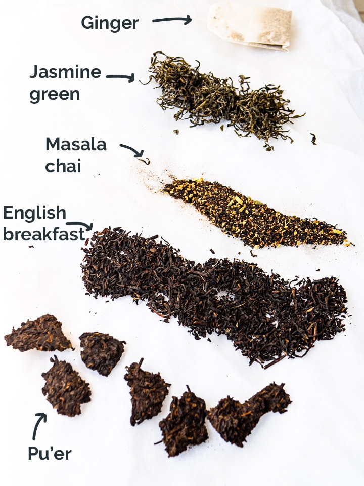 Side by side comparison of 5 types of loose leaf teas - jasmine, masala chai, english breakfast, pu'er tea