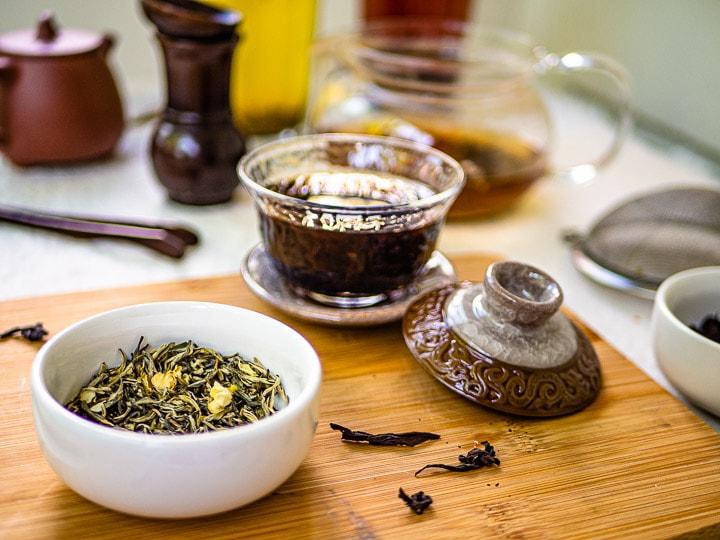 Close up look of jasmine green tea and da hong pao tea with tea pots and tea cups
