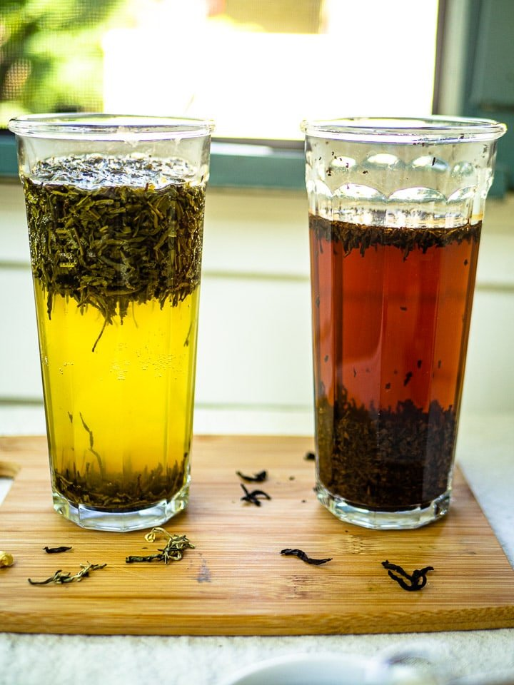 Two tall glasses of cold brew tea - jasmine green tea on the left and english breakfast tea on the right