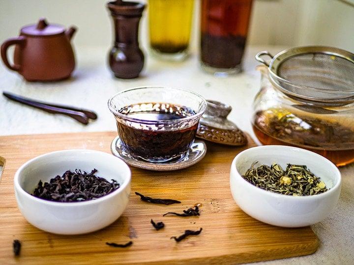 An assembly of jasmine green tea and da hong pao tea with tea pots and tea cups
