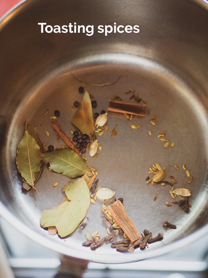 Close up look of toasting spices in a saucepan for the chai taste test