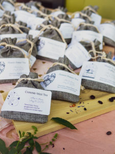 Dozens of burlap sacks with tea and coffee inside for Garlic Delight DIY wedding favor tutorial