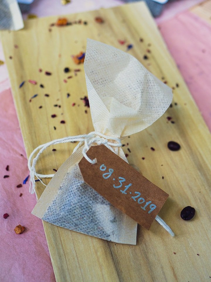 1 tea bag with a brown paper label and coffee inside for Garlic Delight DIY wedding favor tutorial