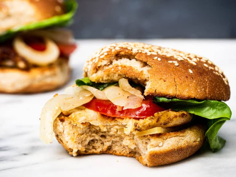 An oyster mushroom burger with a bite eaten out of it