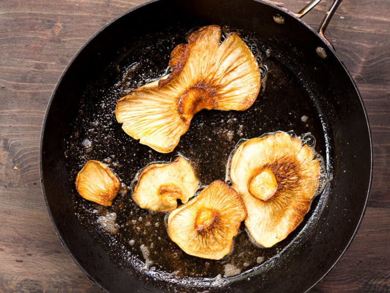 Oyster mushrooms cooking in butter in a fry pan