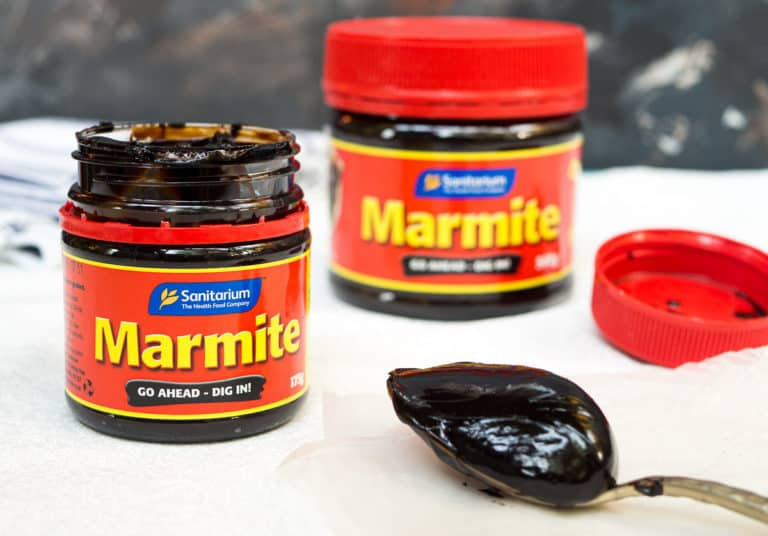 2 bottles of Marmite and marmite on a spoon