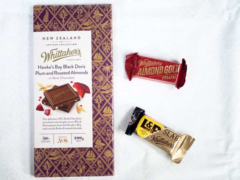 A bar of Whittaker's chocolate next to 2 mini bars with different flavors