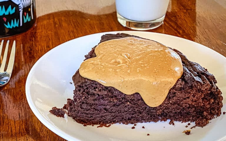 Peanut butter on top of a slice of chocolate cake