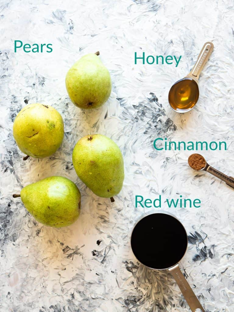 The ingredients for poaching pears in red wine