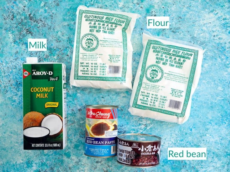 Coconut milk, rice flour, and cans of red bean to show the ingredients for the red bean mochi cake recipe