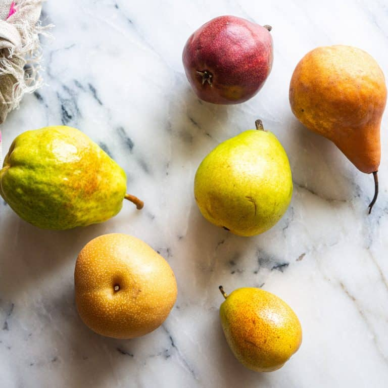 6 different types of pears on a marble background