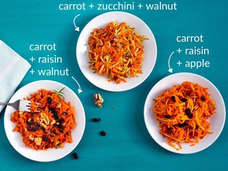 3 plates of grated carrot salad with different mix-ins