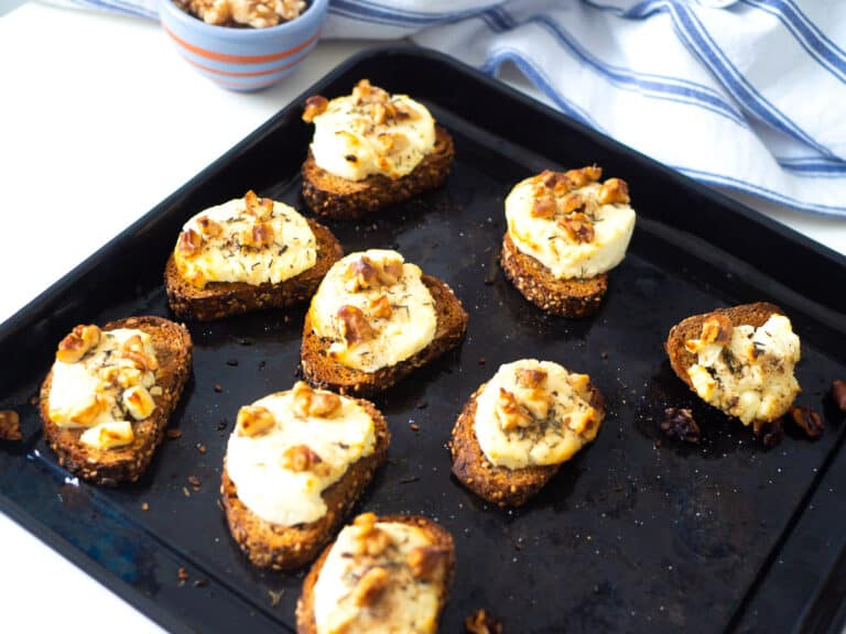 A baking tray with chèvre chaud (warm French goat cheese toast)