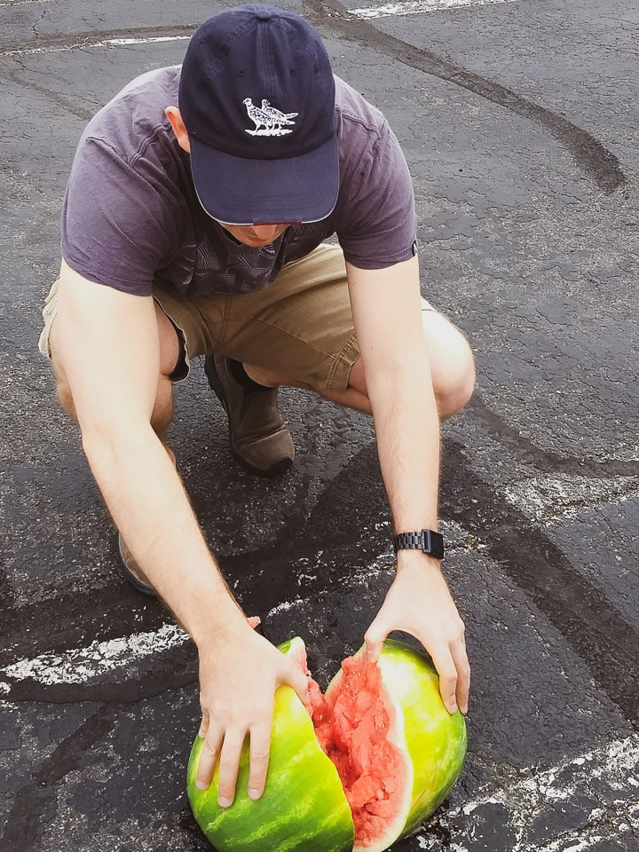 Alex in the Costco parking lot assessing the damage after dropping a watermelon