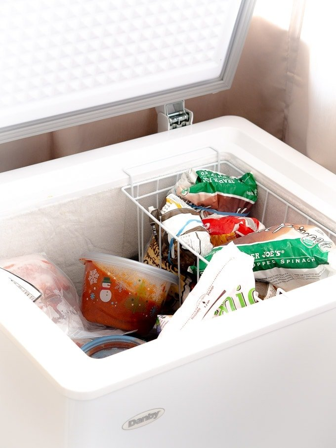 Chest freezer filled with an assortment of batch cooked foods
