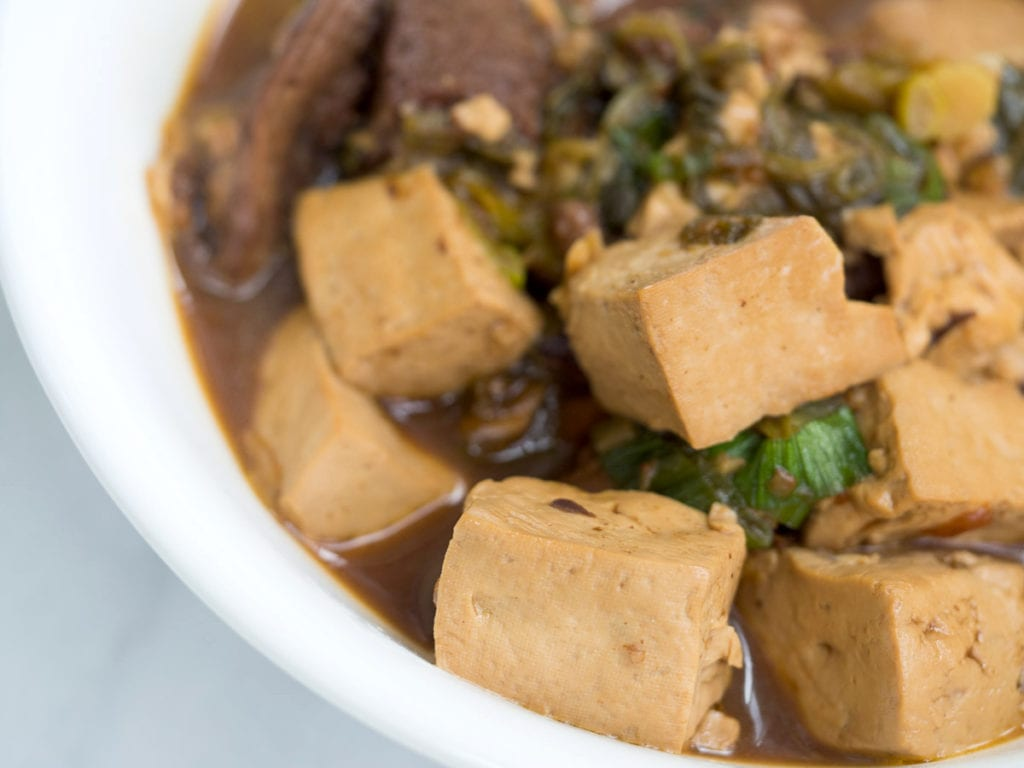 Braised tofu with soy sauce in white bowl