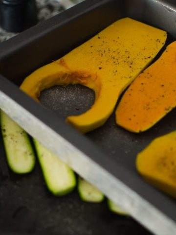 baking trays with the squash and zucchini