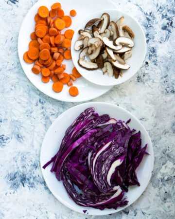 Sliced carrot, mushroom, and red cabbage for a tofu stir fry