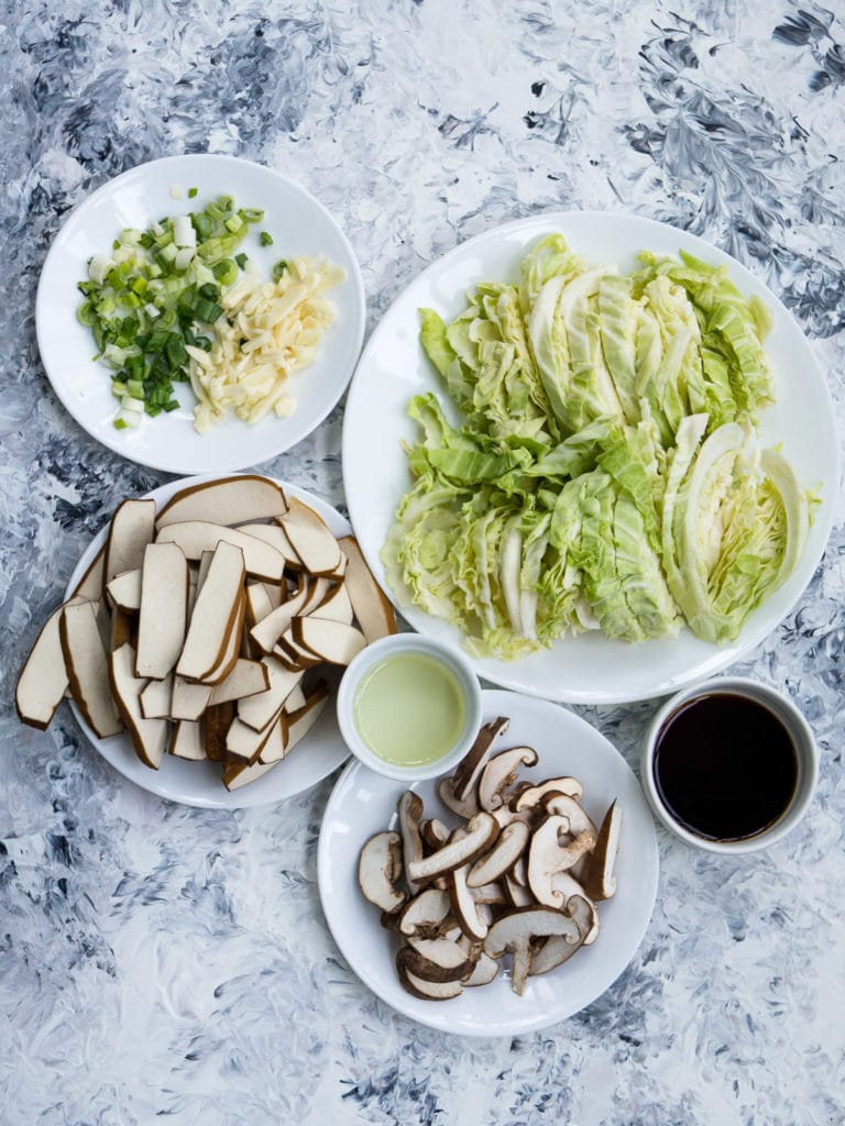 Overhead view of all the ingredients for Stir Fry Cabbage Mushroom Tofu