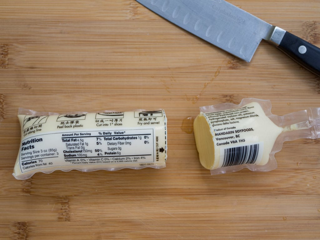 A tube of egg tofu cut open in half to show how to prep egg tofu