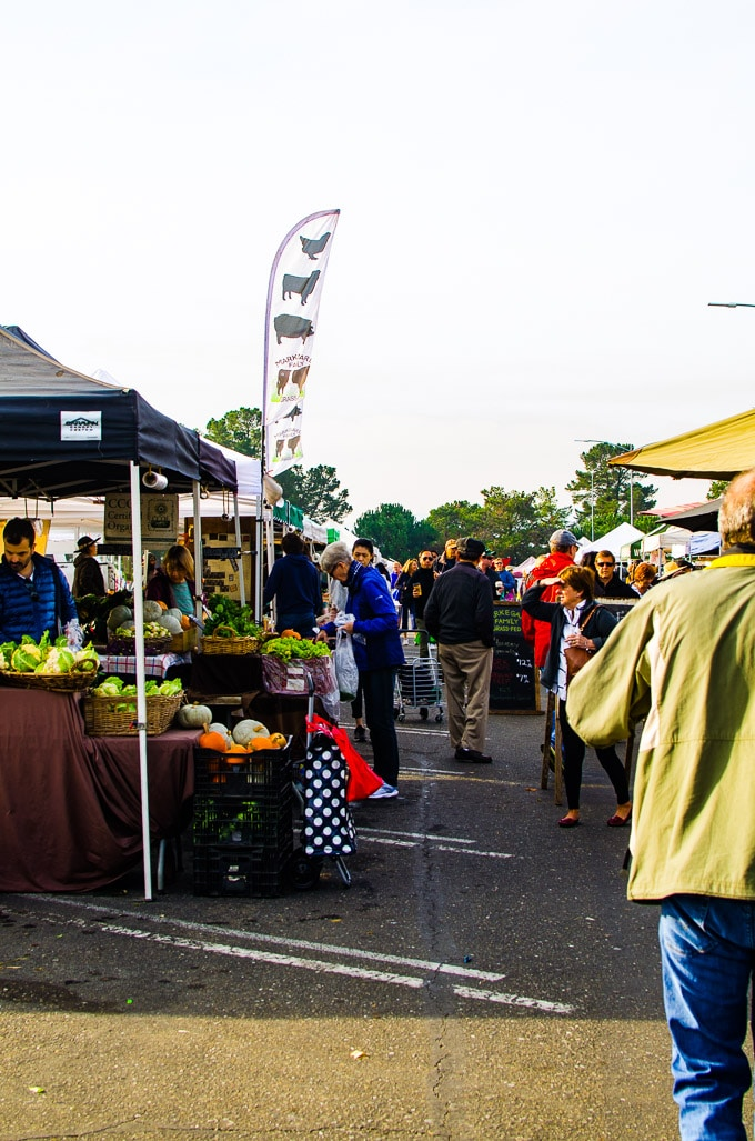 San Mateo Community College Farmers Market on Saturday morning with people and vendors.