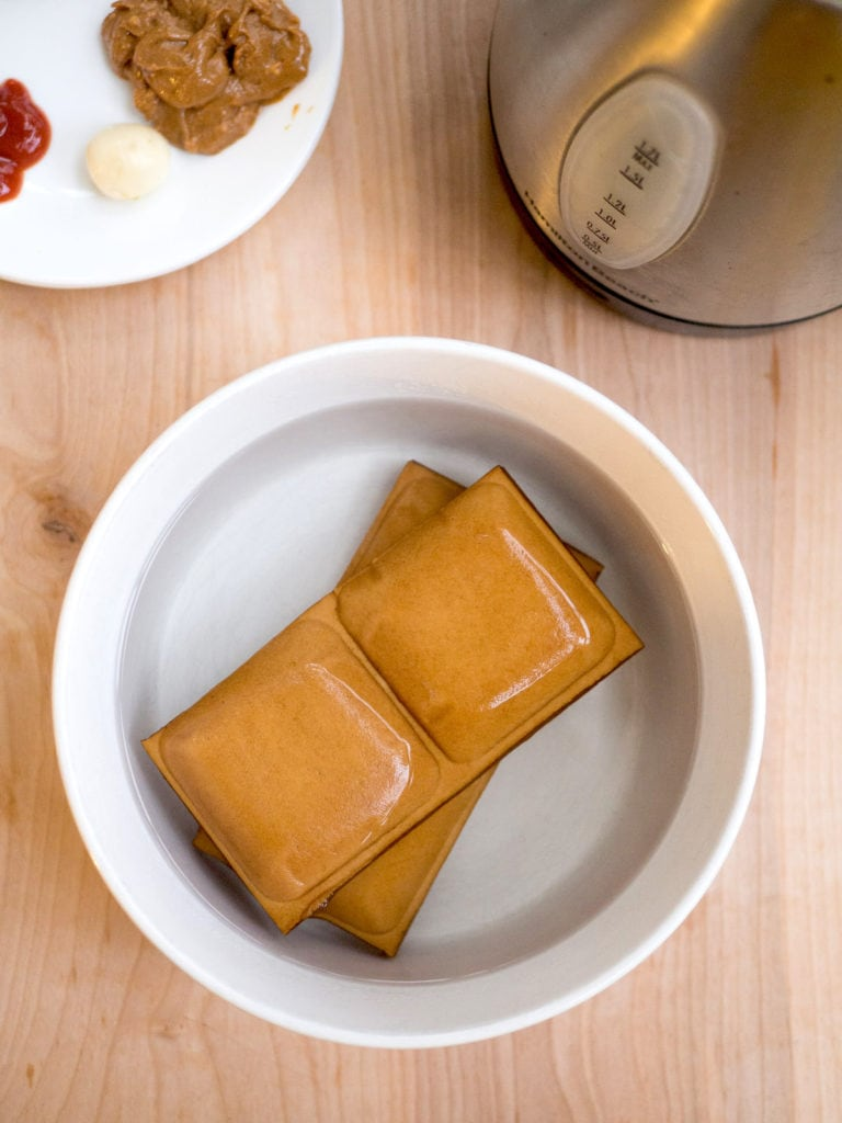 Blanching tofu step for Five Spice Tofu with Ketchup and Peanut Butter Sauce recipe