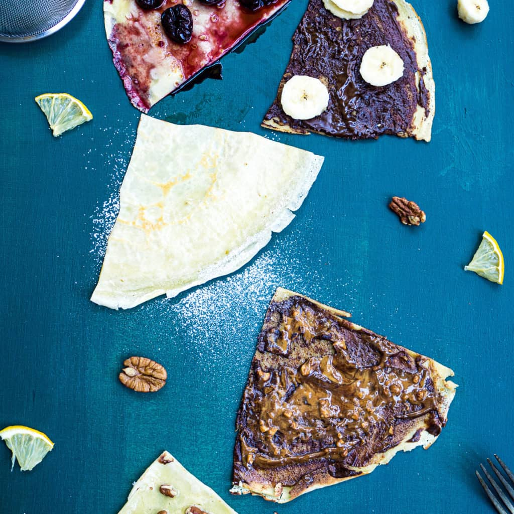 5 different flavored crêpes on a green background