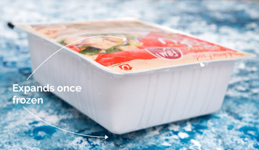 A frozen block of tofu in its original packaging