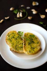 Overhead view of 5-minute garlic bread with cilantro garnish. Recipe from garlicdelight.com.