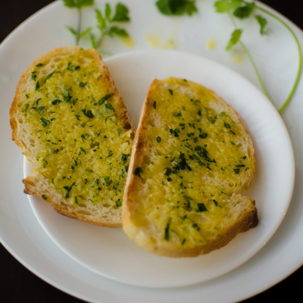 5-minute garlic bread on white plates with cilantro garnish