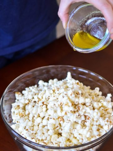 Garlic Butter Popcorn-Pour butter over the popcorn