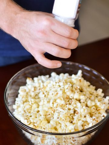 Garlic Butter Popcorn-sprinkle salt on popcorn