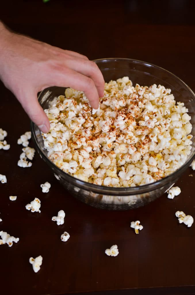 Garlic Butter Popcorn-Alex's hand reaching for popcorn