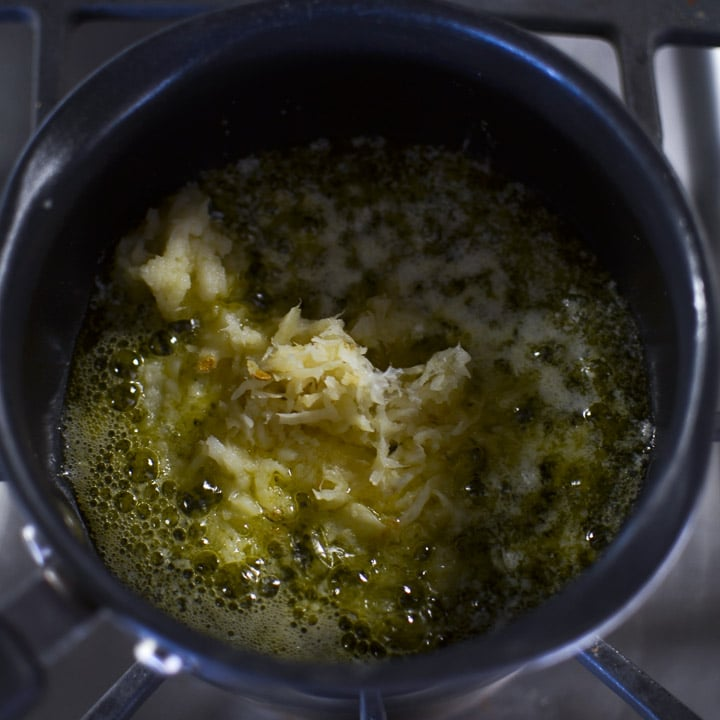 Garlic Butter Popcorn-garlic through the garlic press