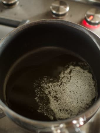 Overhead view of butter melting in saucepan. Recipe from garlicdelight.com.