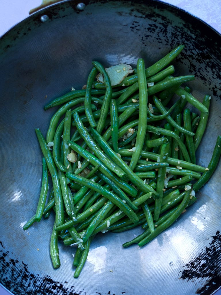 Overhead view of green beans in wok